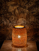 istock Master's handmade wicker lamp, night lamp on the table 1293995784