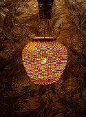 istock Master's handmade wicker lamp, night lamp on the table 1293995818