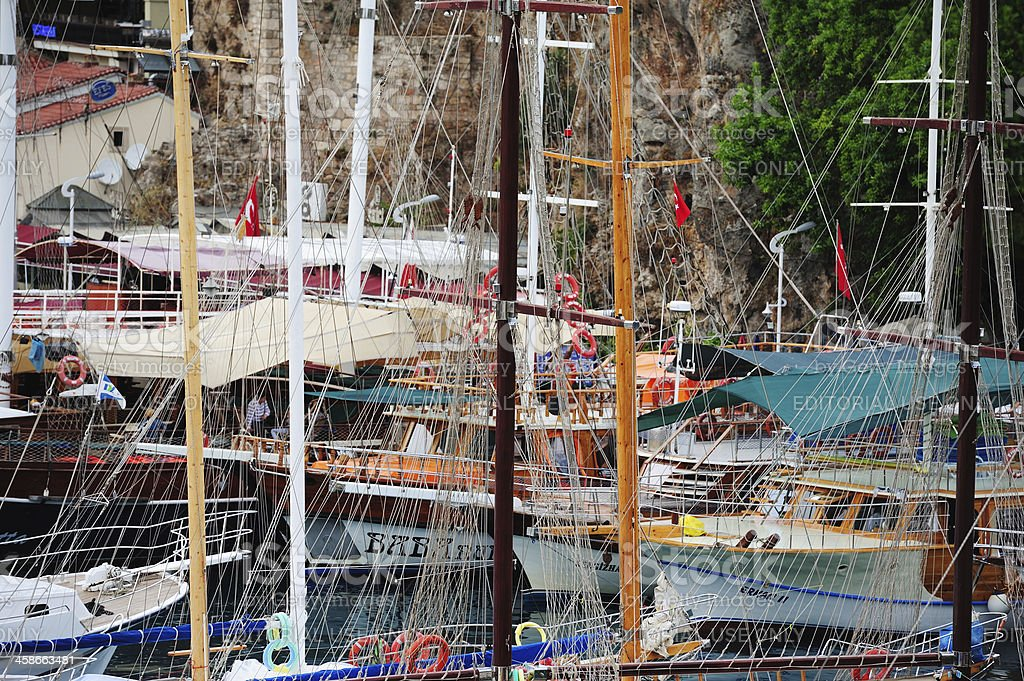 Masts, pulley and ropes in port stock photo