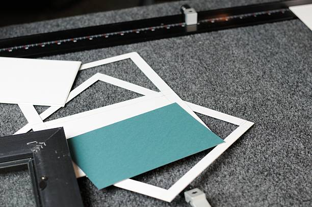 Mat board and cutting machine stock photo