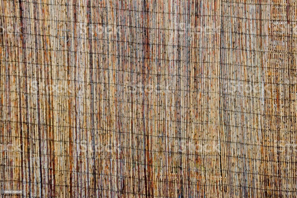 Mat of brown bamboo wire together to create a fence, Plana mountain stock photo