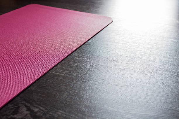 Mat on wooden floor stock photo