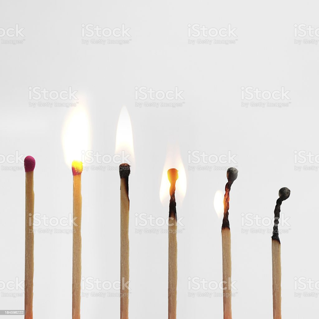 Match burning down image progressionon grey stock photo