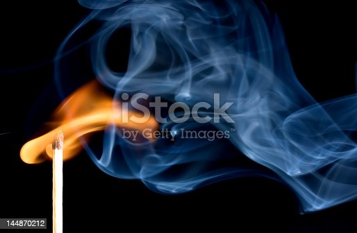 istock A match creating a flame with smoke 144870212