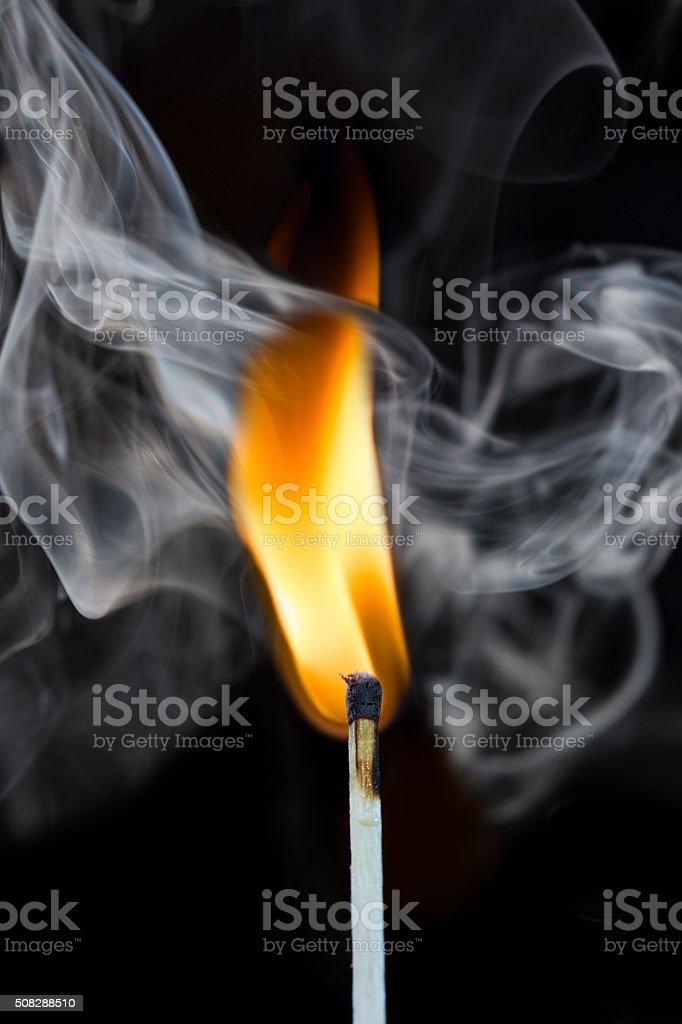 match with smoke on black stock photo