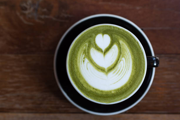 matcha green tea latte on wooden table stock photo
