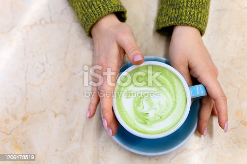 matcha, tea, latte, green, hands, amino acids, antioxidant, authentic, background, beautiful, blue, brew, bright, chlorophyll, concept, cup, day, drink, ecological, energy, female, flat lay, foam, food, good, gut, health, healthy, holding, hot, japanese, leaves, life, milk, mug, natural, nobody, object, pattern, powdered, pure, real, table, time, top view, trendy, vegan, vegetarian, woman, women