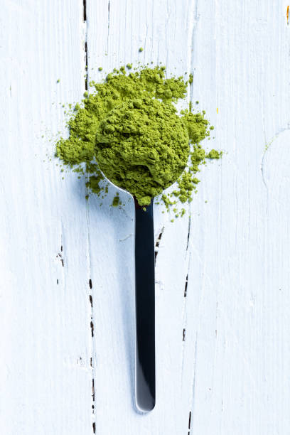 matcha green tea on spoon stock photo