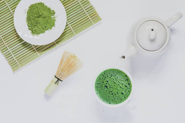 Matcha green tea on white wood stock photo