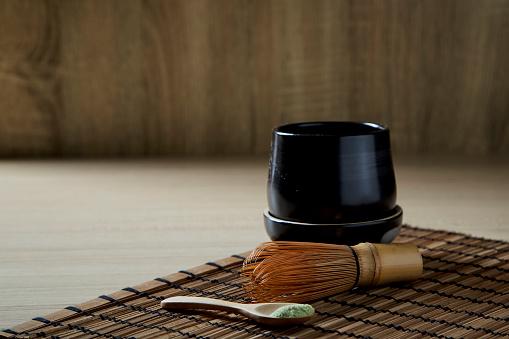 Matcha green tea on wood background