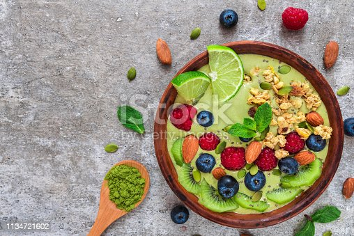 istock matcha green tea smoothie bowl with fresh fruits, berries, nuts, seeds and granola for healthy vegetarian diet breakfast 1134721602