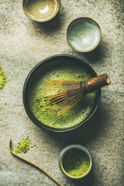 Matcha powder, Chashaku spoon, Chasen bamboo whisk, Chawan bowl, cups stock photo