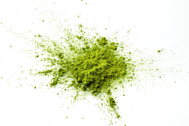 Matcha powder explosion on white background top view. stock photo