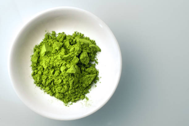 Matcha powder in white bowl stock photo