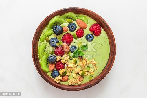 istock matcha tea green smoothie bowl with fresh berries, nuts, seeds and homemade granola for healthy vegan diet breakfast 1083796198