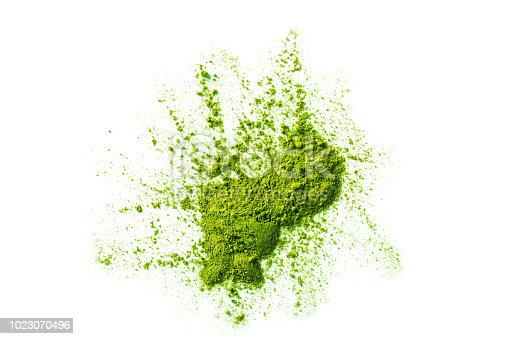 green matcha tea powder ground in erratic form isolated on white background