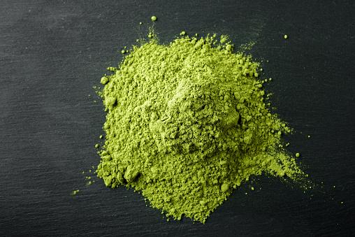 Matcha Tea- Japanese green tea on a black stone background