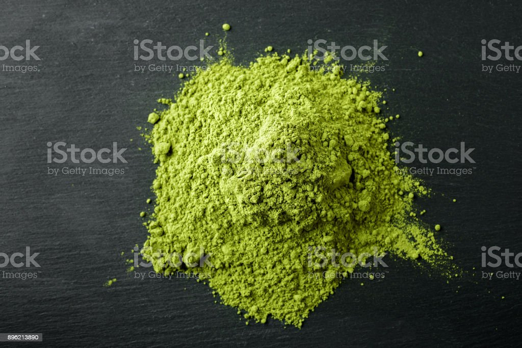 Matcha Tea- Japanese green tea on a black stone background stock photo