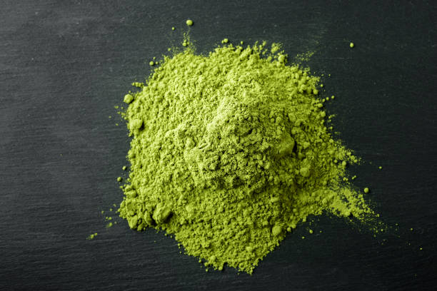 Matcha Tea- Japanese green tea on a black stone background stock photo