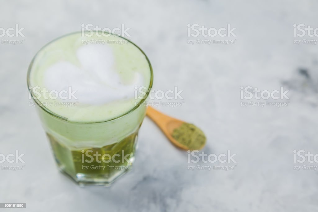Matcha tea super latte on marble background stock photo