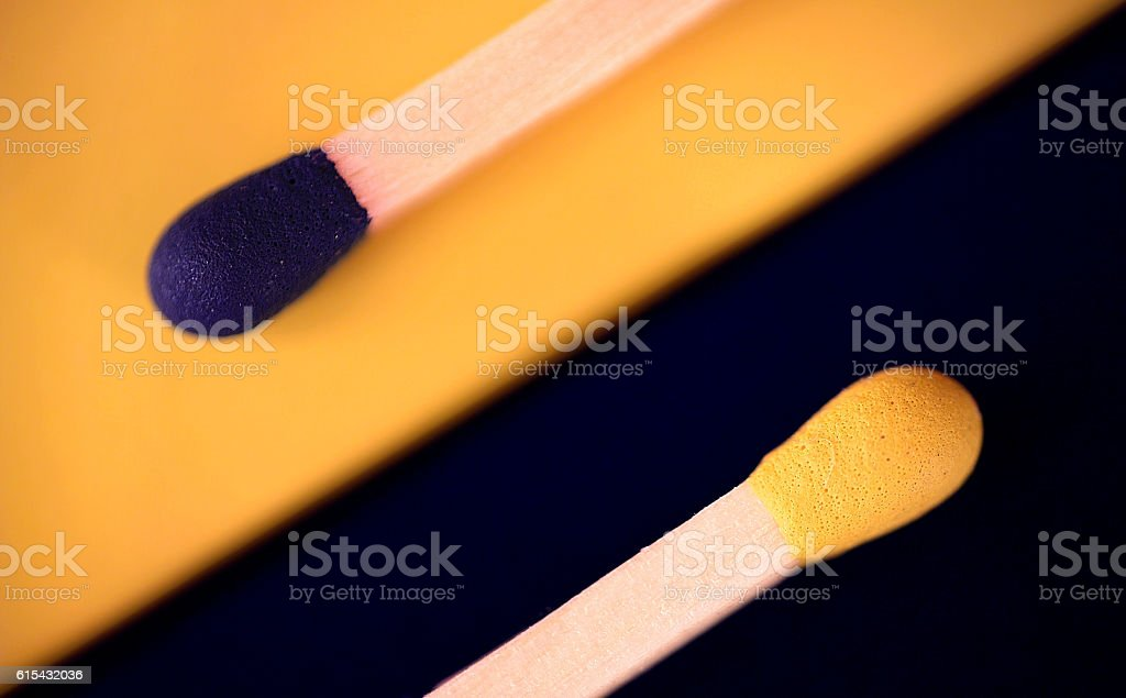 Matches in blue and yellow color stock photo