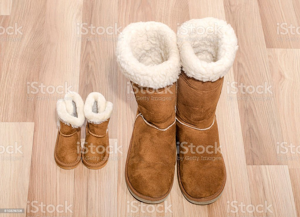 Matching big and small boots. stock photo