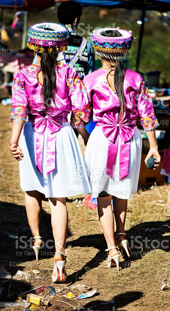 Matching Friends in Hmong Traditional Clothing stock photo