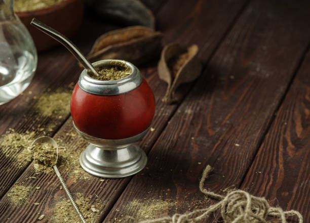 Cтоковое фото Mate yerba tea in calabash on wooden table. Traditional argentinian beverage