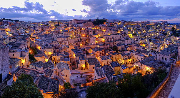 Matera at Night Panoramic view of Sasso Barisano at the blue hour. matera italy stock pictures, royalty-free photos & images
