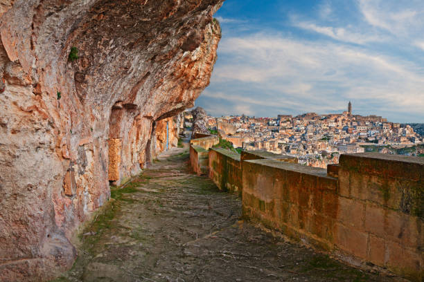 Matera, Basilicata, Italy: alley carved in the rock with the ancient cave houses Matera, Basilicata, Italy: alley carved in the rock with the old cave houses in the ancient Italian city European capital of culture 2019 tuff stock pictures, royalty-free photos & images