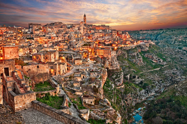 Matera, Basilicata, Italy: landscape of the old town Matera, Basilicata, Italy: landscape at dawn of the old town (sassi di Matera) and the creek at the bottom of the deep ravine matera italy stock pictures, royalty-free photos & images