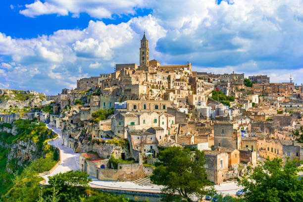 Matera, Basilicata, Italy: Landscape view of the old town - Sass Matera, Basilicata, Italy: Landscape view of the old town - Sassi di Matera, European Capital of Culture, at dawn matera italy stock pictures, royalty-free photos & images