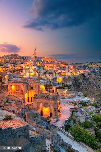 Cityscape aerial image of medieval city of Matera, Italy during beautiful sunset.