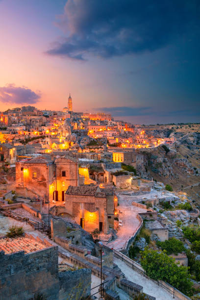 Matera, Italy. Cityscape aerial image of medieval city of Matera, Italy during beautiful sunset. matera italy stock pictures, royalty-free photos & images