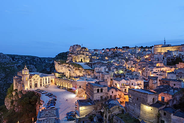 Matera Sassi cityscape by night, Basilicata Italy Matera Sassi cityscape by night, Basilicata Italy matera italy stock pictures, royalty-free photos & images