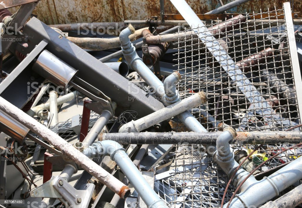material and old iron pipes in the landfill of recyclable materi stock photo