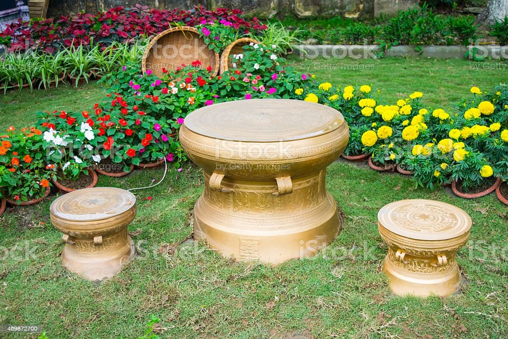 material bronze drums on grass in vietnames stock photo