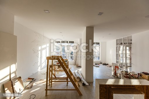 istock Material for repairs in an apartment is under construction, remodeling, rebuilding and renovation. Making walls from gypsum plasterboard or drywall. 1075980364