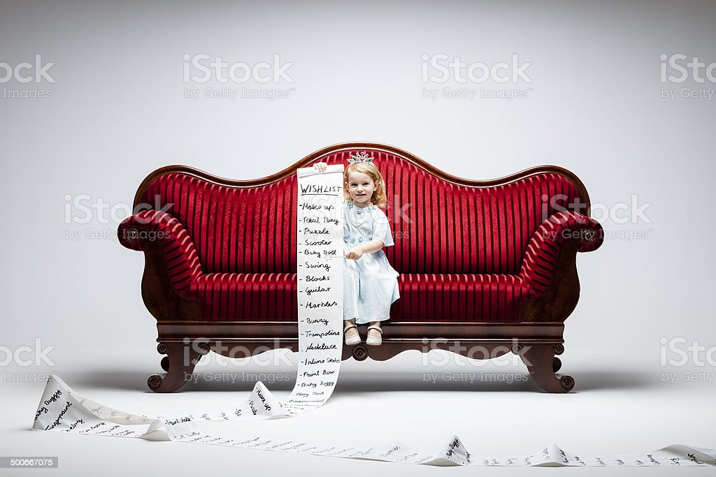 Material Girl -Princess Wish List Humor Child Sofa Consumerism stock photo