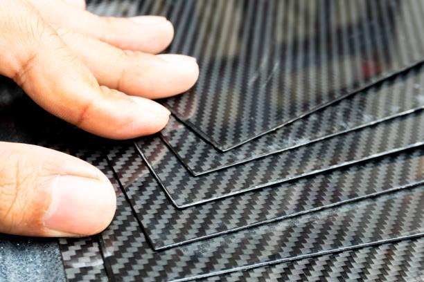 Material of composite product dark carbon fiber plate - foto stock