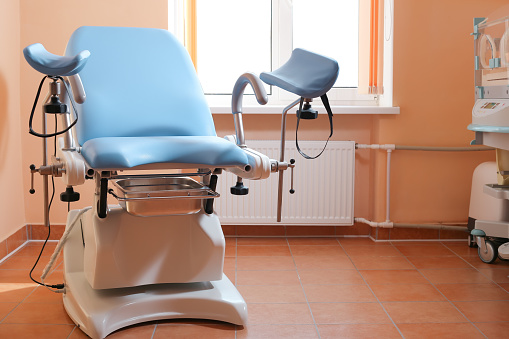 Maternity chair in the surgical obstetric ward. Chair for inspection of pregnant women. Inspection room in the hospital.
