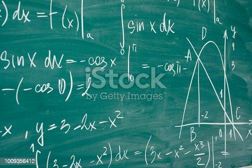 istock Math class. Algebra. The formulas are written on the school board 1009356412