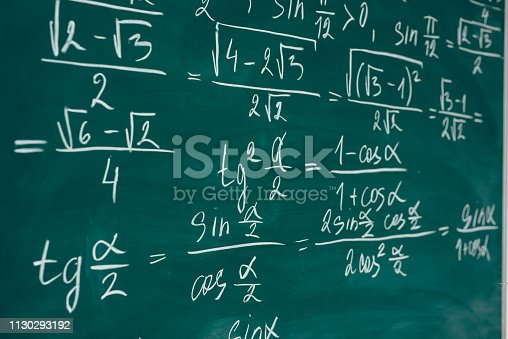 istock Math class. Algebra. The formulas are written on the school board 1130293192