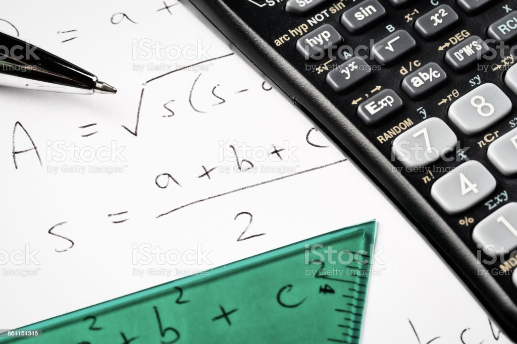 Math equation with calculator, set square, and pen royalty-free stock photo