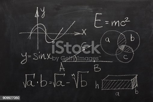 istock Math formulas on black chalkboard 909927050