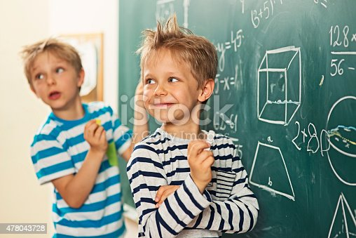 istock Math is fun - boys standing at the blackboard 478043728