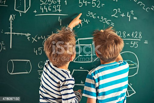 istock Math is fun - little boys solving mathematical problems 478097132