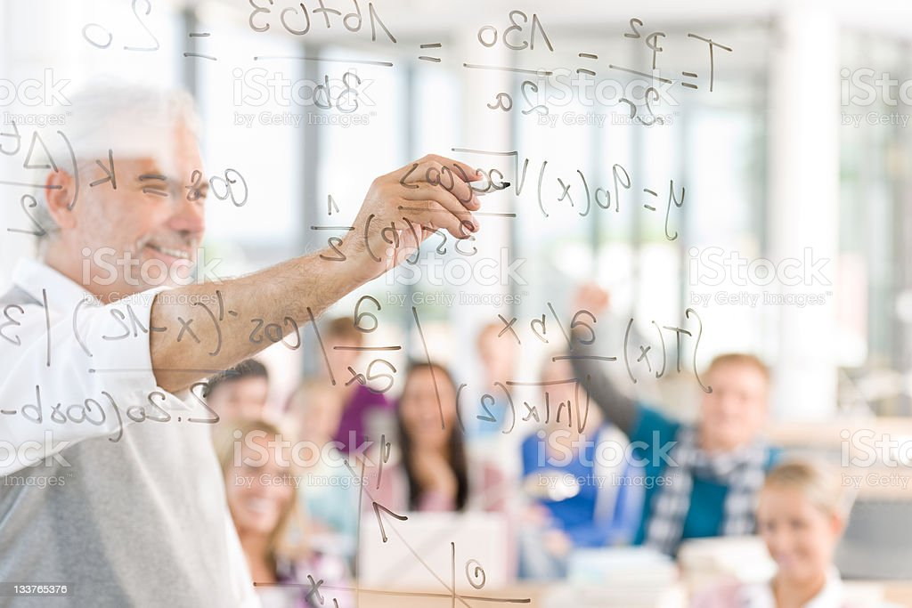 Math lesson at high school - students with professor stock photo