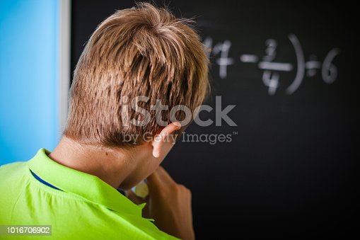 531869550 istock photo Math Lesson  - Teenager Solving Mathematical Equation 1016706902