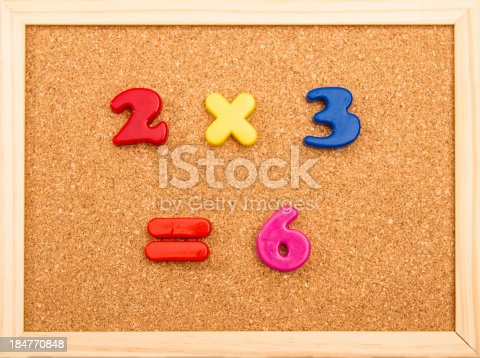 Simple mathematic multiplication on a wooden frame cork board